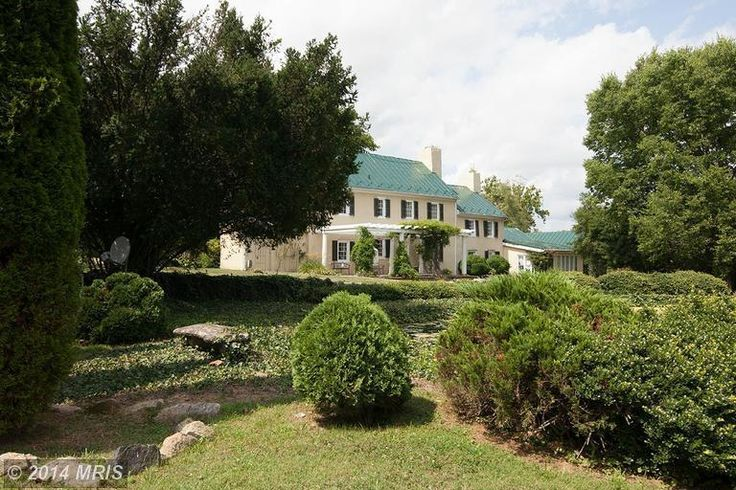 Magnificent 155 Acre Atoka Road Estate with gated entry opening into the private drive lined with mature trees. The charming historic manor home, c. 1827 backs to expansive views of fields and ponds.