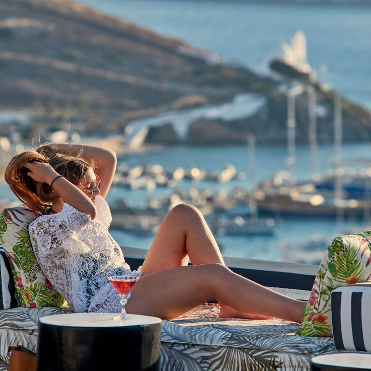 Who is looking forward to sinking into a comfy couch and soaking up the sun while sipping cocktails at Liostasi Hotel & Suites?