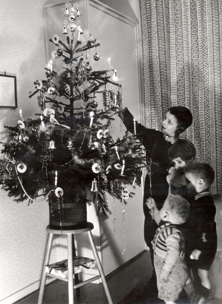 Kerstboom met echte kaarsen.