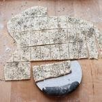 Transfer the crackers to a lightly floured baking sheet using a metal pastry scraper or spatula.