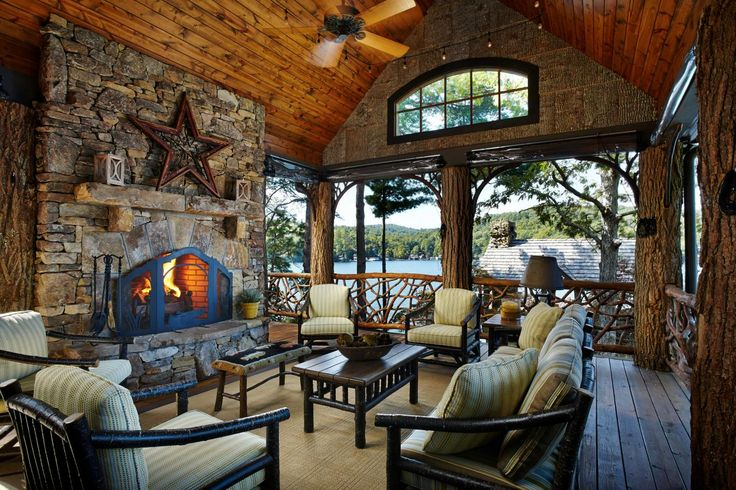 The two-story boathouse features this outdoor living room with locust tree trunk posts and beams, mountain laurel railings, a glorious stone fireplace and long range mountain and sunset views.