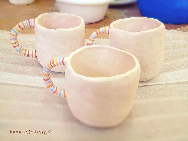 My new pinched barrel mugs totally white with colourful handles. Already bisque fired and now I think I'll show 'em the way to the glaze room before the 2nd firing. It's funny and so creative, I've been working on new designs the last month.