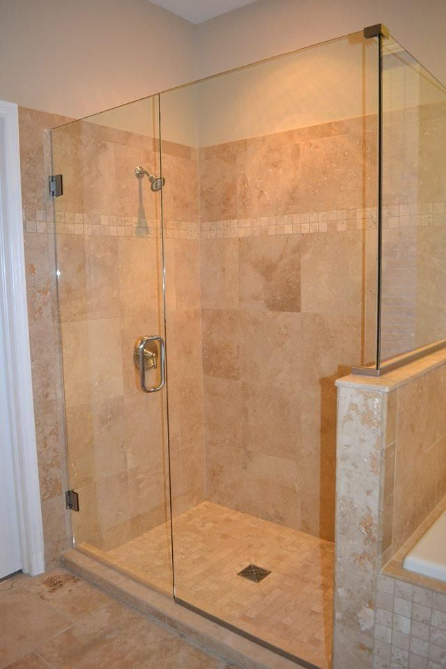 Travertine shower, tub & floor installation in Wesley Chapel, Florida (18x18, 2x2 & French pattern) #travertine #tile #wesleychapel #ceramictec