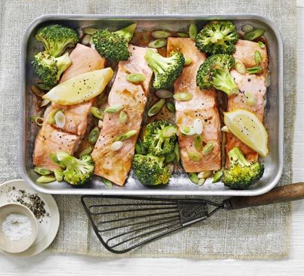 Oriental salmon & broccoli traybake. Five ingredients is all you need to create this Asian-flavoured fish dish with healthy greens and fresh lemon.