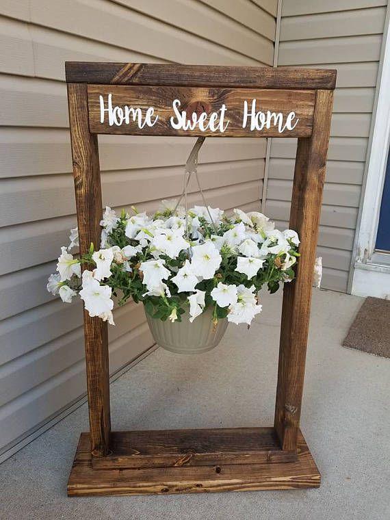 hanging flower basket stand comes in several different colors stains dark walnut ebony. Black Bedroom Furniture Sets. Home Design Ideas