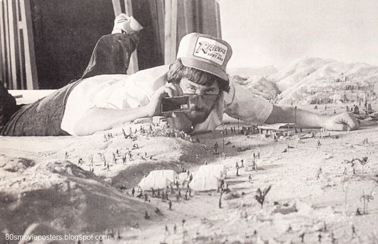 Steven Spielberg checking a miniature set for the first Indiana Jones movie.