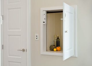 Dumbwaiter, simple using a garage door opener system. Much cheaper than other products. YouTube it.