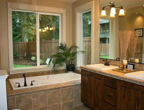 Bathroom remodeling ideas. I like the bathtub covered in tiles