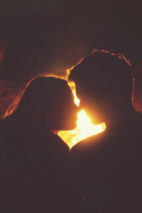 Fireside kiss love cute couples kiss outdoors fire camping glow