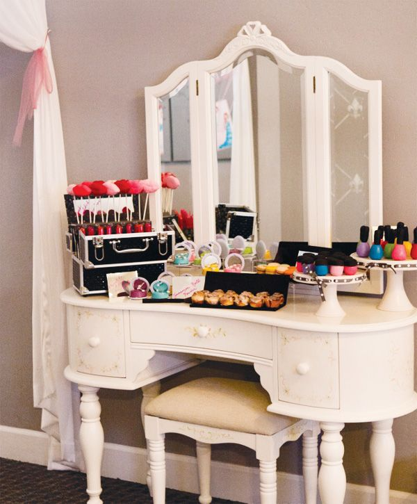 """""""Makeup"""" styled dessert table with nail polish and lip cake pops. I particularly like that it's set up on a vanity."""