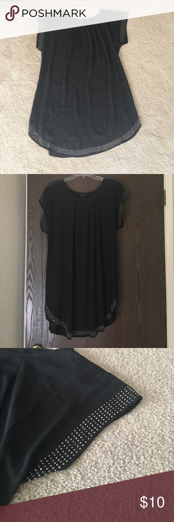 Black shift dress Brand new with tags!! Black shift dress with silver beaded accents around arms and bottom of the dress. Perfect for a date night! Dresses Midi