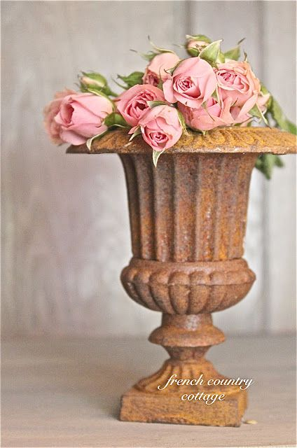 FRENCH COUNTRY COTTAGE: A Romantic Vignette with a rusty urn and roses