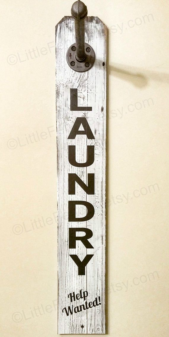 This laundry sign is decorative and functional, performing double duty as a clothing rack. Ships ready to hang with all pipe and hanging hardware included. We attach the Flange to the sign for you. You only need to mount the sign to your wall and screw the pipe in. Shown in white distressed with hand painted black lettering ~no vinyl here! Pipe is shown in Black Night. ✿ FEATURES ~Decorative and Functional ~Solid cedar wood ~Hand painted ~Rustic and Industrial ~All hanging hardware included…