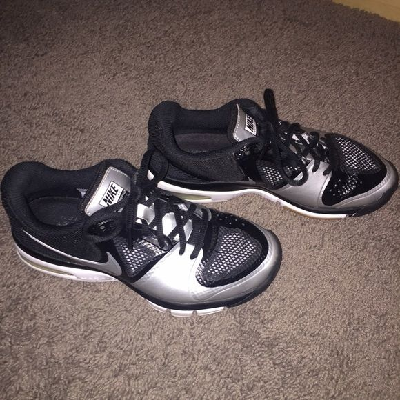 Nike volleyball shoes Black and silver volleyball shoes. Only worn for one season. Still in great condition. No scuffing on the toes. Size 6.5 but I am an 8 and they fit Nike Shoes Athletic Shoes