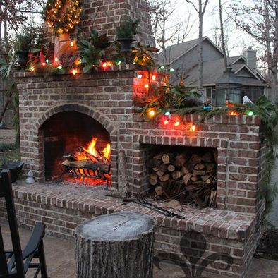 Outdoor fireplace dress up in it's holiday decor