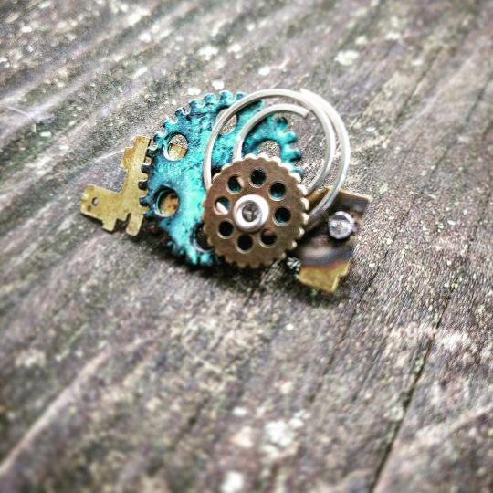 Item details 5 out of 5 stars. (290) reviews Shipping & Policies Made with silver, antiqued brass, and oxidized green gears, this fun pin is sure to impress! Made using salvaged parts sourced from a retired Detroit machinist!