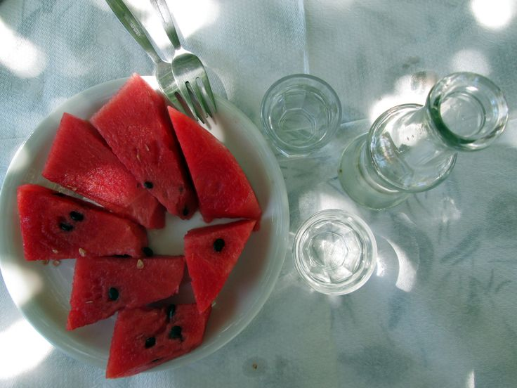 Complementary watermelon washed down by Cretan spirit - raki at 'Dionyssos' in Preveli