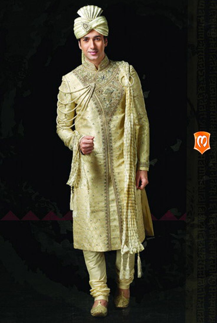 The Manyavar silk embroidered sherwani :- This sherwani weaved on layers of silk is the expression of a groom to be. Self keri designs,butta sequins, and studded stones elaborates the grand flavor of this attire.  #Manyavar #Sherwani #Wedding #Indian Wedding Wear #Manyavar Sherwani #Manyavar Wedding Wear #Celebration Wear #Special Occasion #Indian Ethnic Wear