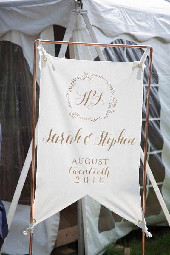 "Names and Date Wedding Banner This listing is for one wedding banner approximately 24""x36"". Banner is made of canvas in an ivory colour. Vinyl adhesive wording is in a rose gold colour but can be customized. Banner includes 4 eyelet holes ( two at top, two at bottom) for easier set up. Personalize Monogram Initials inside the wreath are separated by & We are very open to customizations! Dont be shy to send us a message and we can work on a custom sign together! Sizes and wording can be ..."