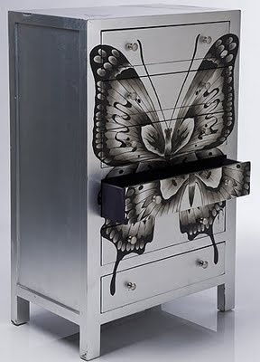Finished in gently-distressed silver leaf with a satin lacquer topcoat, each beauteous black butterfly is painted on by hand. And as a decadent finishing touch, the drawers are lined with a rather regal deep purple. Want it? It's yours for £925, from The French Bedroom Company.