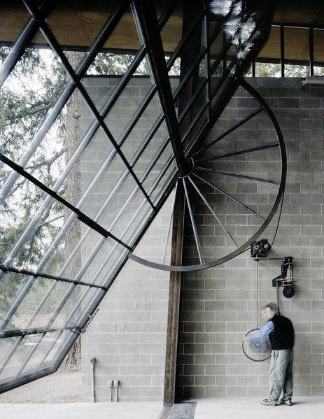 Ouverture de la porte basculante vitrée du loft