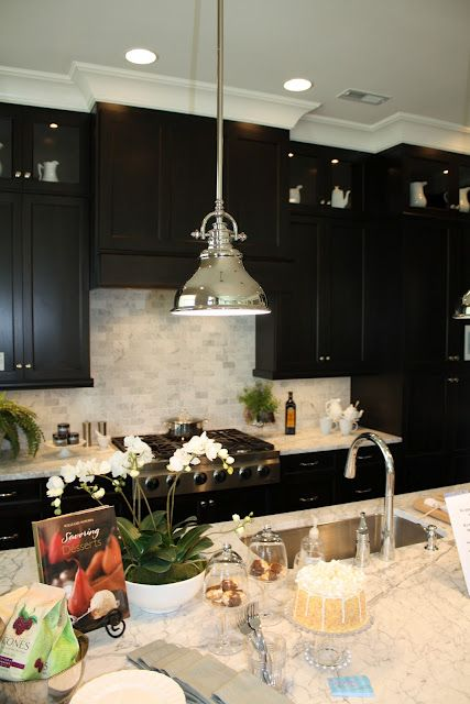 Dark cabinets with light counters and backsplash. Almost same layout as new house