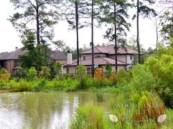 Great view of a lake with brick houses at the distance - Gallery - Woodlands Realty Pros