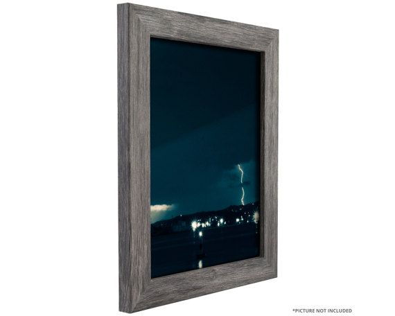 Rustic style picture frame; distressed gray tones; smooth wood grain finish (not actual barnwood) Frame includes: glass, rigid black backing and pre-attached stamped hanging hardware Frame holds a 11 inch by 14 inch photo/print (viewable area is slightly smaller) Frame moulding is 1.26 inches wide; wood composite material Made in the U.S.A.  With clean rectilinear lines and square profile, this picture frame is ideal for most modern decor needs. The Bauhaus picture frame series features ...