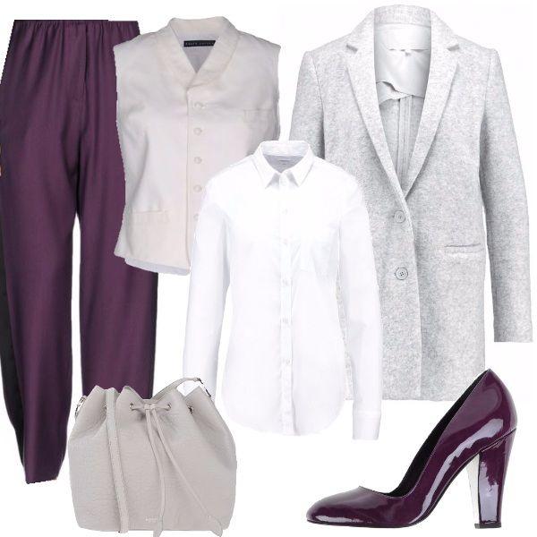 Un look alternativo, per una donna sicura di sé: pantaloni morbidi viola con camicia bianca classica e gilet bianco con colletto. Ai piedi una décolleté di vernice viola come i pantaloni. Per uscire un cappotto in lana grigio chiaro, con una borsa a sacco dello stesso colore, in pelle.