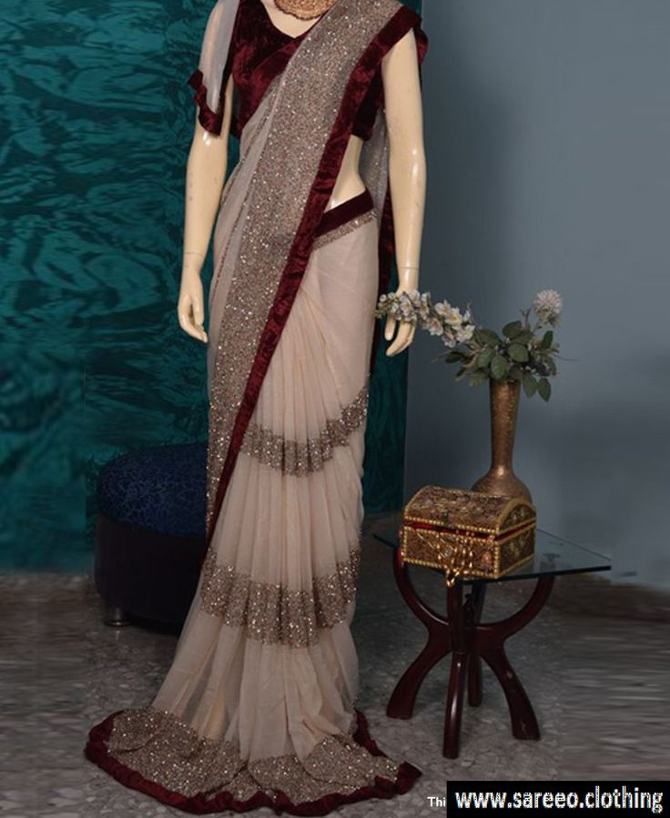 Cream colour Full Sequence Work Georgette Saree With Velvet Blouse . Type :- Branded Sequence Collection Saree Saree Fab :- Heavy Designer Geogette Saree with Full fancy Heavy Sequence Work In saree All sequence work are doing iun saree not lace put in saree Blouse Fab :- Heavy VelvetBlouse in this saree Lace :- Heavy Maroon coloer Velvet lace in saree Saree Cut :- 5.5 Mtr Blouse Cut :- 0.80 mtr Set :- 1 saree::1 Blouse Work :- Full Sequence Work In saree Occation…