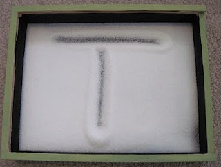 Salt box for learning letters - I would use sand instead...