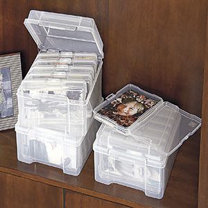 """NEW! Photo Storage Box - Keep up to 600 photos organized and in clear view! This archival box includes six individual photo cases that each holds up to 100, 4"""" x 6"""" or 3"""" x 5"""" photographs. $14.98 CAD"""
