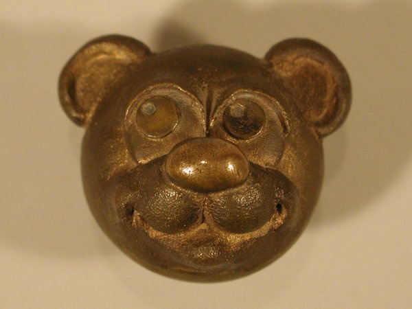 A Very Old Door Knob Shaped Like A Teddy Bear S Head