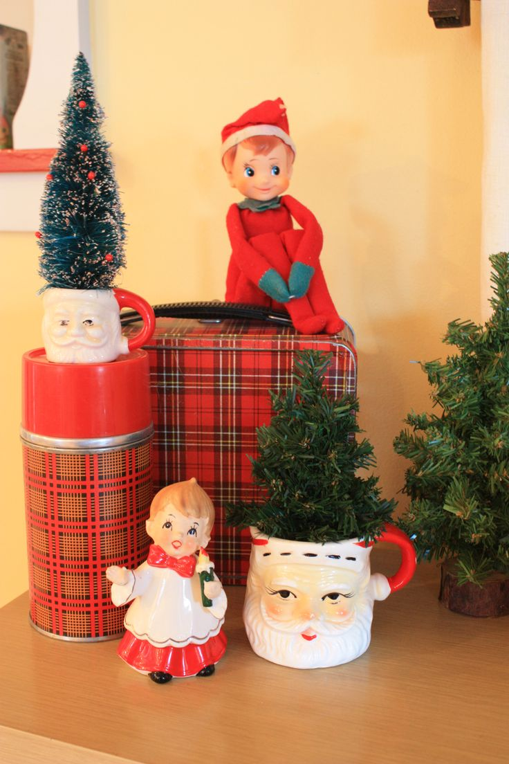 I love making little vintage groupings, this is in the kitchen and features some vintage Santa mugs, bottle brush tree, vintage choir boy figurine, a vintage Aladdin thermos and lunch box and an original knee hugger elf.