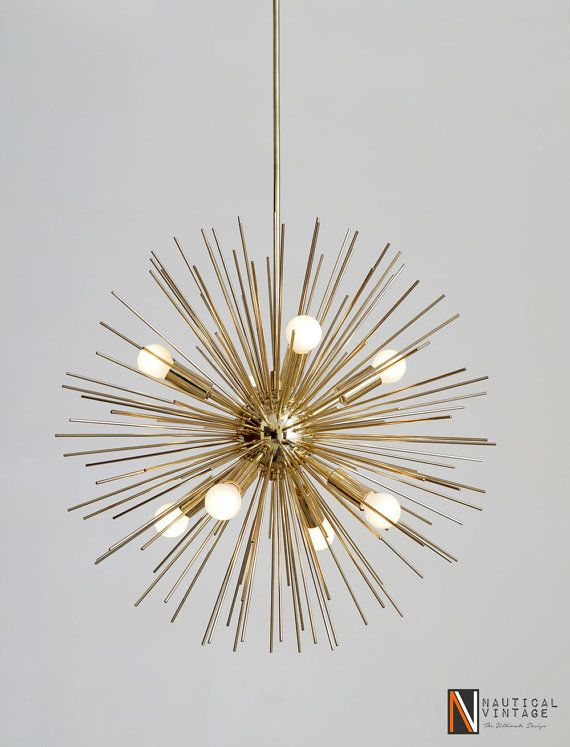 Product Detail: This style of brass urchin leaf chandelier is great for a transitional space that isn't fully traditional but isn't fully modern and sleek either.  Beautiful Vintage inspired 8 Bulbs polished brass urchin leaf chandelier adorned with high quality brass spines radiating from each of 8 stem of light.  A complete set including fixture, ceiling canopy and installation hardware. Can be hung on a ceiling with up to a 45 degree slope. Perfect addition to your home decor and easily…