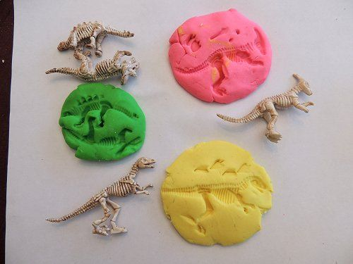 Make your own dinosaur fossil imprints with these neat figurines and some model magic.