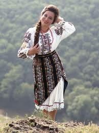 Young woman in folk costume of Moldova.