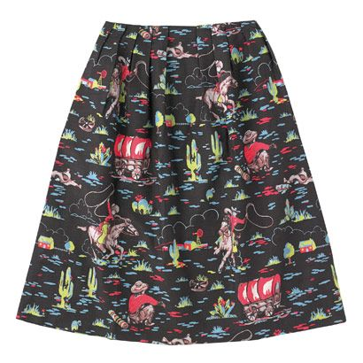 Cowboy Pleated Slub Skirt | Cath Kidston | A graceful skirt that flows from the waist to just below the knee, and fastens with a prim Petersham bow. It's one of the styles to feature our new take on the iconic cowboy print – re-coloured in a new midnight blue hue for a complete makeover.
