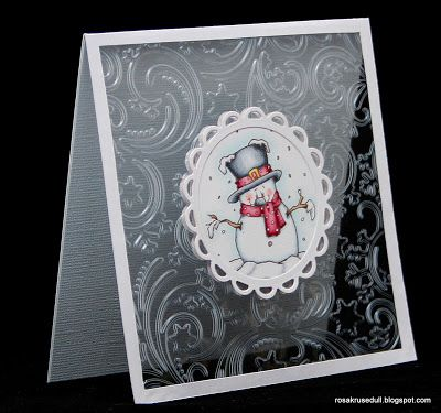handmade Winter card from min rosa krusedull ... embossing folder texture on clear acetate front ... snowman on a medallion ... wonderful card!!