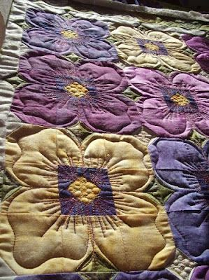 Pieced to be quilted like this.  Pansy Quilting by Kim Stotsenberg