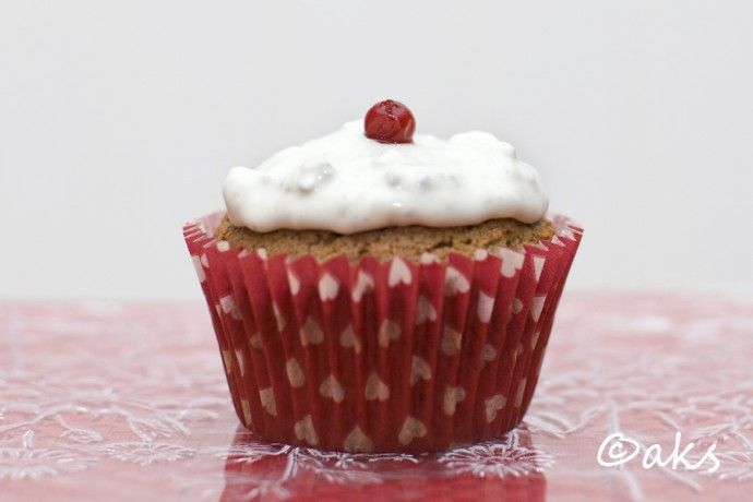 Soft gingerbread muffins with lingonberries and green cheese frosting.
