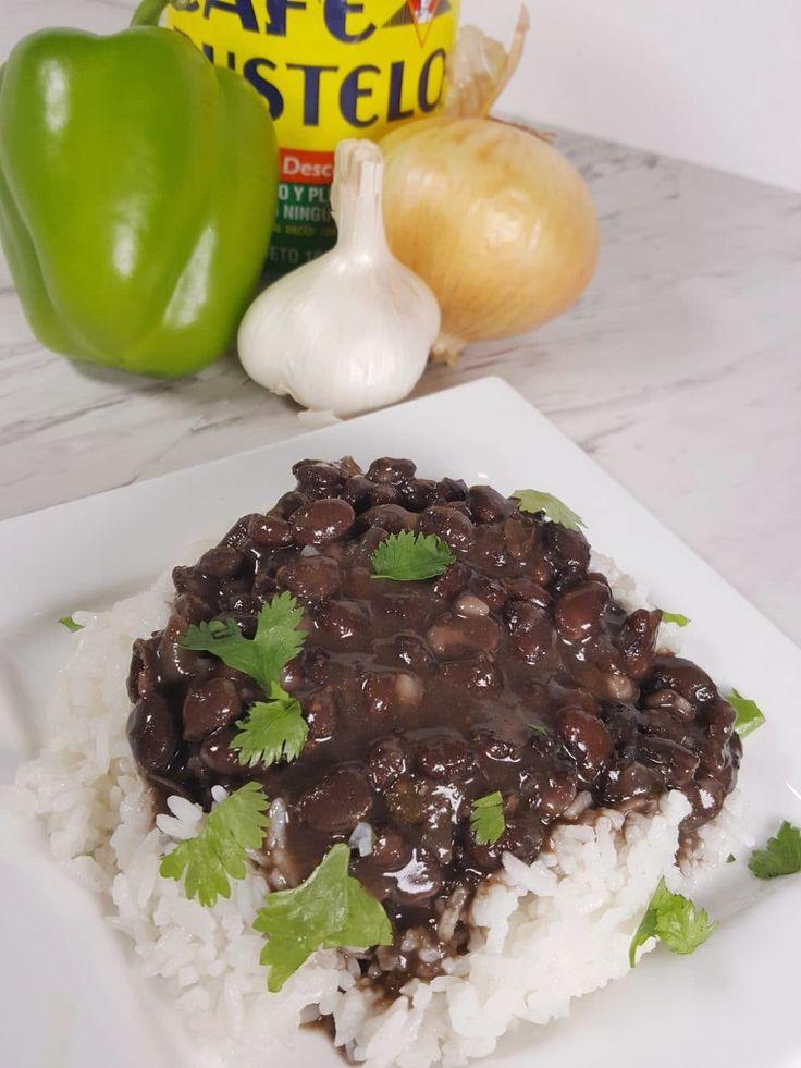 Pressure Cooker Cuban Black Beans{Frijoles Negros}  - easily veganized by omitting the ham hock and using liquid smoke.  Good information on Sofritas and Cuban cooking here.