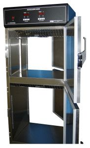 Pass Through Blanket warmer  and/or Solution Warmer from http://continentalmetal.com/products/pass-through-warming-cabinets/,with locking doors on each side. A Lead lined option is also available as well as  interlock system.