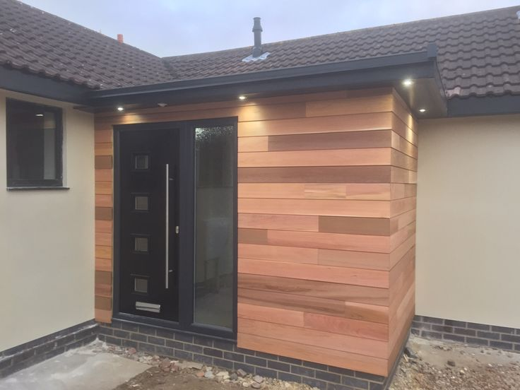 Black Door in timber clad porch - they compliment each other perfectly!  Many more contemporary doors for you to design online so you can benefit from maintenance free style with all the benefits of Composite Doors #LoveYourDoor