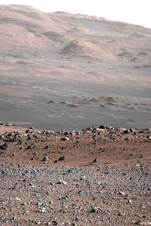 A colour image released by NASA on August 28, 2012 and taken on August 23 shows Mount Sharp in the background taken by the 34-millimeter Mast Camera on NASA's Curiosity rover.