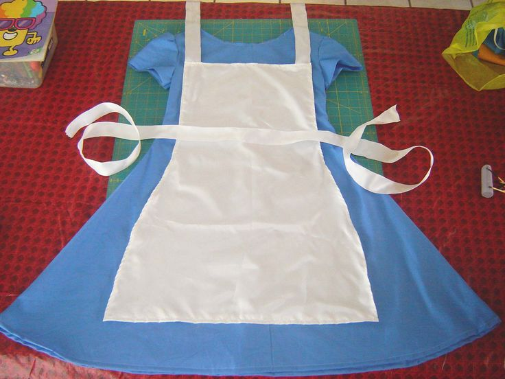 Quick, inexpensive, and simple DIY Alice in Wonderland costume instructions. Make the dress and apron on a budget in just 1-2 hours.
