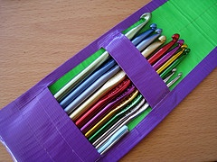 Duct tape crochet hook holder How cute! This was made by dvorty girl and I found it on Flickr Her inspiration was from a pencil case on wikihow