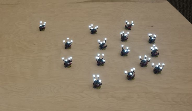 The Robotarium: A remotely accessible swarm robotics research testbed Figure 8: Example of a 15 robot swarm of GRITSBots on the arena surface of the second instantiation of the Robotarium. When developing algorithms for coordinating the behaviors of swarms of robots it is crucial that the algorithms are actually deployed and tested on real hardware platforms. Unfortunately building and maintaining a swarm robotics testbed is a resource-intense proposition and as a consequence resources…