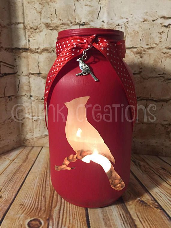 When a Cardinal Appears in your yard its a visitor from Heaven, Cardinal painted mason jar tea light candle, holder.  Saying is on back of the jar. (white vinyl)  7 inches tall, 32 oz painted mason jar.(quart size)  Color in photo Red. The jar is hand painted with 3 to 5 coats and a