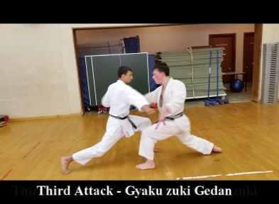 Shotokan Karate Kumite exercise. Attack gyaku zuki, block gedan barai gyaku zuki, whilst moving towards the on coming atttack. http://karateclassesonline.com/simultaneous-block-and-counter-shotokan-karate-kumite-exercise/